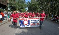 Members of the Plumbers & Pipefitters Local 119 march in the Labor Day Parade Monday Sept. 2, 2013 in downtown Mobile, Ala. (Bill Starling/bstarling@al.com)