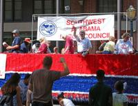 Members of the Southwest Labor Council aboard the lead float throw toilet paper to the waiting crowd during the Labor Day Parade Monday in downtown Mobile, Ala. (Bill Starling/bstarling@al.com)