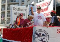 Members of the Southwest Labor Council aboard the lead float throw toilet paper to the waiting crowd during the Labor Day Parade in downtown Mobile, Ala. (Bill Starling/bstarling@al.com)