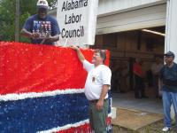 Decorating the Southwest Alabama Labor Council Float at UA Local 119.